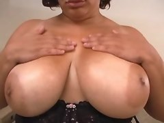 Fat lady with large tits sucks cock